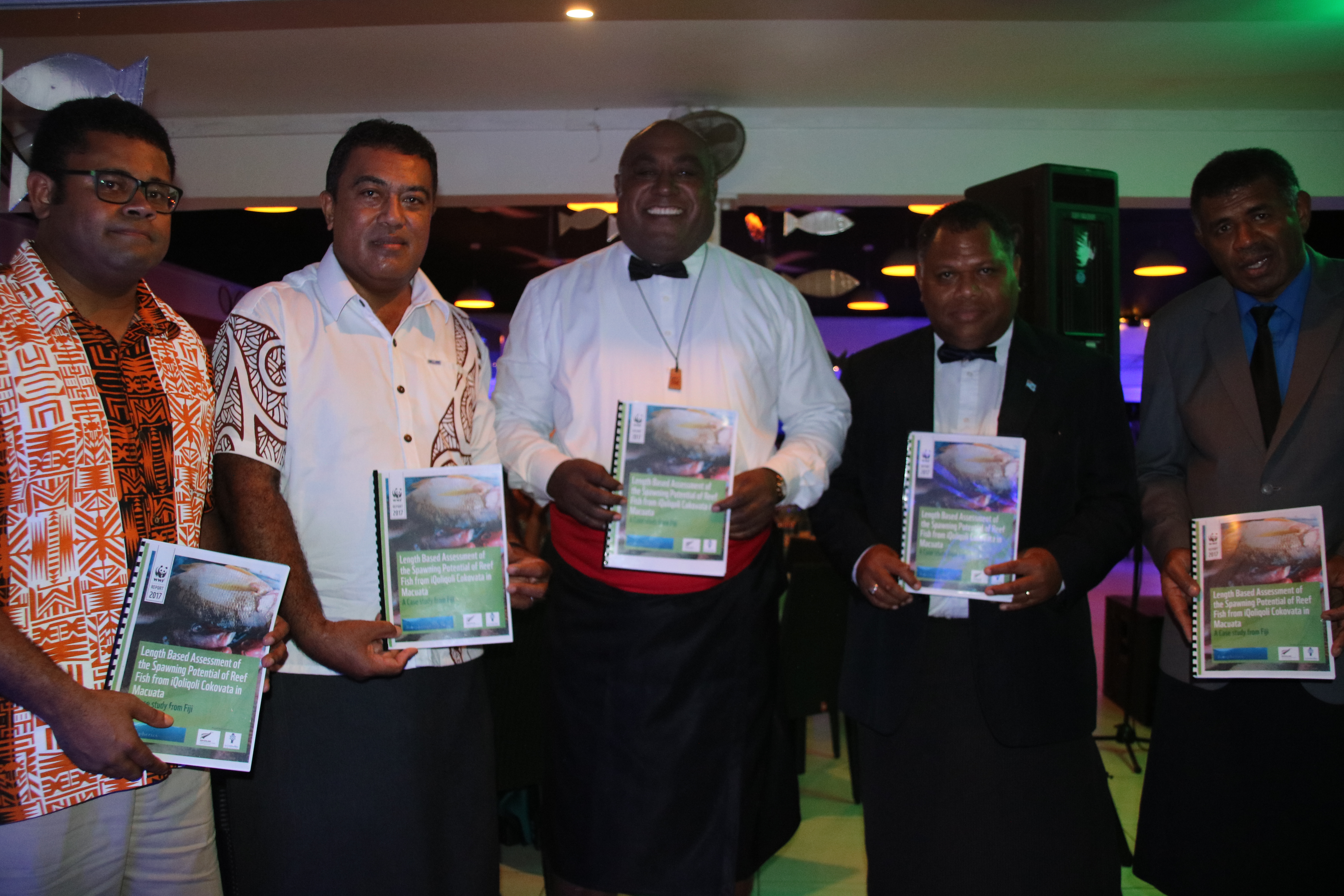 Minister of Fisheries Semi Koroilavesau (c) with fisheries stakeholders and WWF-Pacific's Laitia Tamata (Far Left) with the LB-SPR Macuata reports (credit: WWF Fij)